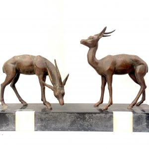 Statue en bronze d'un couple d'antilopes sur marbre