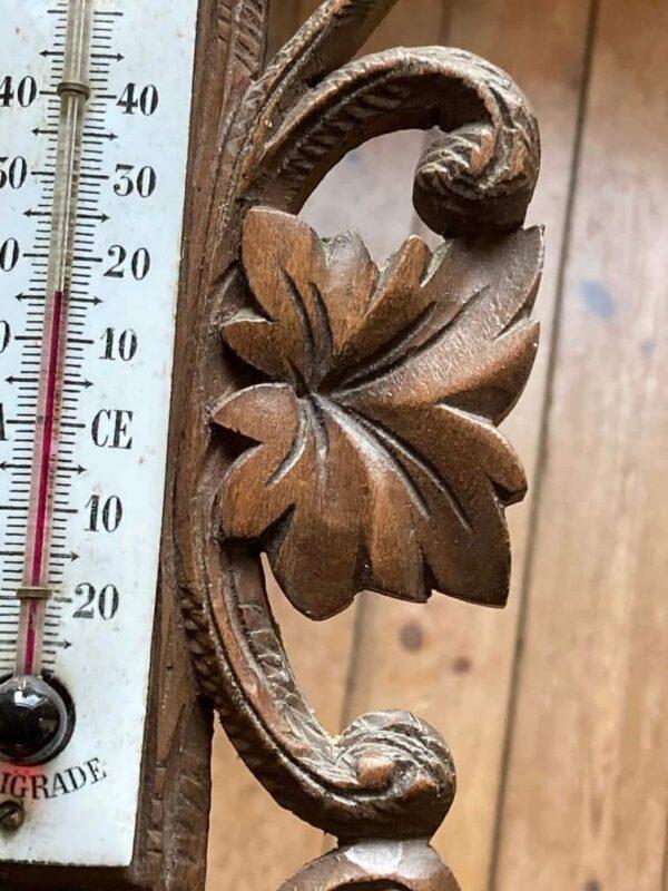 baromètre thermomètre en bois sculpté décor forêt noire feuillages