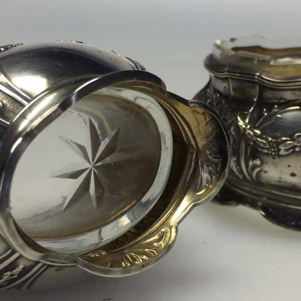 Paire de salerons en argent - style Louis XV dessous du verre